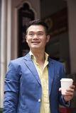 Happy Asian man out walking in the city. Stock Photography
