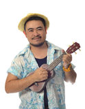 Happy Asian man playing Ukulele isolate background Royalty Free Stock Images