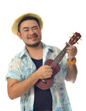 Happy Asian man playing Ukulele isolate background Stock Photos