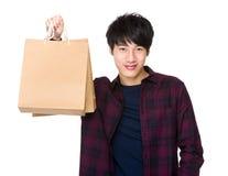 Happy Asian man shopper holding shopping bag Royalty Free Stock Image