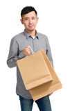 Happy Asian man shopper Stock Image