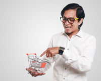 Happy Asian Man With Shopping Trolley Royalty Free Stock Photo