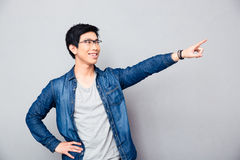 Happy asian man showing finger away Royalty Free Stock Photography
