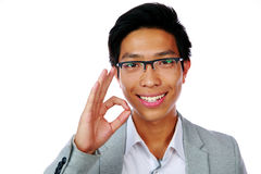 Happy asian man showing okay sign Stock Image