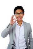 Happy asian man showing okay sign Royalty Free Stock Photography
