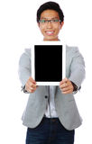 Happy asian man showing tablet computer screen Royalty Free Stock Image