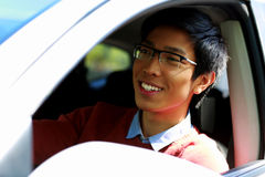 Happy asian man sitting in car Stock Image