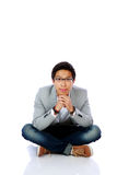 Happy asian man sitting on the floor Stock Image