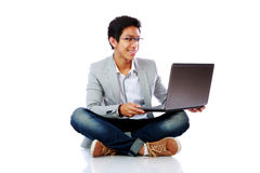 Happy asian man sitting on the floor Stock Images