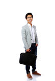 Happy asian man standing with briefcase Stock Image