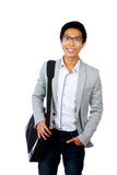 Happy asian man standing with briefcase Royalty Free Stock Photos