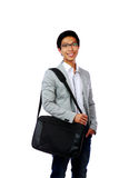Happy asian man standing with briefcase Stock Images