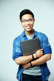 Happy asian man standing with laptop Royalty Free Stock Photos