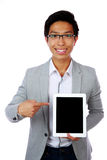 Happy asian man standing with tablet computer Royalty Free Stock Photography