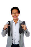 Happy asian man trying to choose a tie Stock Photography