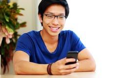 Happy asian man using smartphone Royalty Free Stock Photo