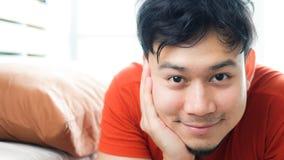 Happy Asian man wake up. Happy Asian man just woke up stock images