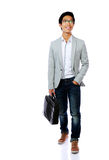 Happy asian man walking with briefcase Stock Photography