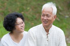 Mature Asian couple outdoor portrait. Royalty Free Stock Image