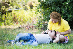 Happy asian mom with cute little boy at the park Royalty Free Stock Images