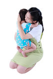 Happy asian mother carrying her daughter. Isolated on white back Stock Photo
