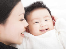 Happy asian Mother and daughter or son smiling together Royalty Free Stock Photography