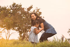 Happy asian mother and her kid playing together with fun Royalty Free Stock Photos