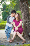 Happy Asian mother with her son at park. Happy Asian family ,mother and son hugging in love playing in the park Royalty Free Stock Images