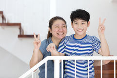 Happy asian mother and son take a photo at home . Royalty Free Stock Photos