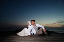 Happy asian muslim couple outdoor on pier Stock Photography