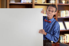 Happy asian nerdy man showing blank white board for copyspace Royalty Free Stock Images