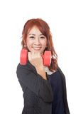 Happy Asian office girl lift a red dumbbell Stock Image
