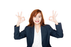 Happy Asian office girl show OK sign with both hands Stock Photos