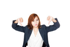 Happy Asian office girl show thumbs down with both hands Royalty Free Stock Photos