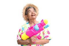 Happy Asian older woman playing water gun on white background Royalty Free Stock Image