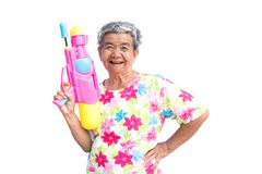 Happy Asian older woman playing water gun on white background Royalty Free Stock Photos