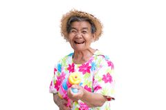 Happy Asian older woman playing water gun on white background Stock Photo