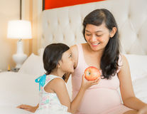Happy Asian Pregnant Mother and Child Royalty Free Stock Photo