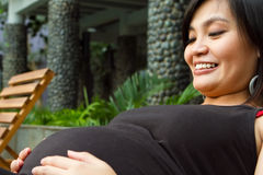 Happy Asian pregnant woman Stock Image