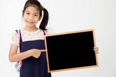 Happy Asian preteens girl hand holding wood board Stock Photo