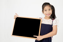 Happy Asian preteens girl hand holding wood board. On gray background with smile face Royalty Free Stock Photography