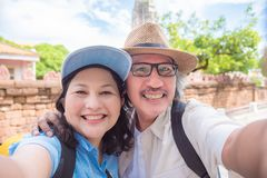 Retired couple taking their photo by smart phone royalty free stock image