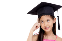 Happy Asian school kid graduate in graduation cap Royalty Free Stock Photo