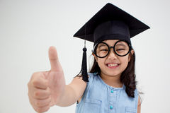 Happy Asian school kid graduate in graduation cap Stock Images