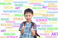 Happy Asian schoolboy wearing backpack and giving thumbs up Stock Image