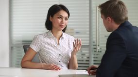 Happy asian seeker or insurance broker consulting client handshaking hr