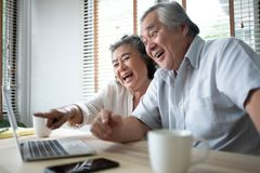 Happy Asian Senior couple having fun royalty free stock photo