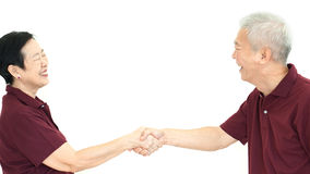 Happy asian senior couple holding hands on white isolate backgro. Happy asian senior couple holding hands promis abstract Royalty Free Stock Photos