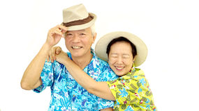 Happy Asian senior couple hugging happily wearing hat ready for Royalty Free Stock Photos
