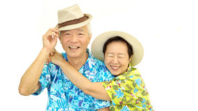 Happy Asian senior couple hugging happily wearing hat ready for Stock Photo